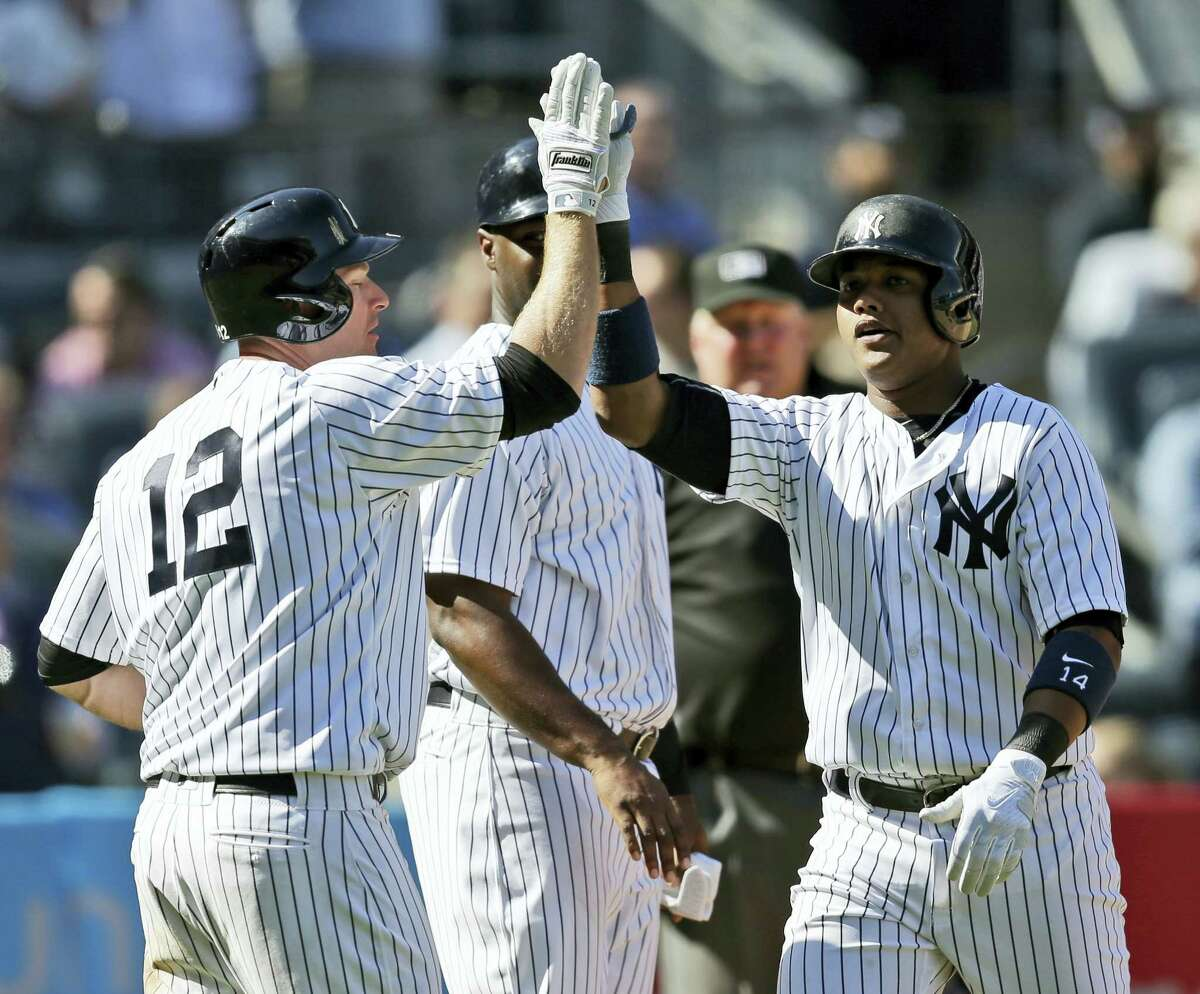 Starlin Castro, right, celebrates his two-run homer with Chase Headley during the eighth inning.