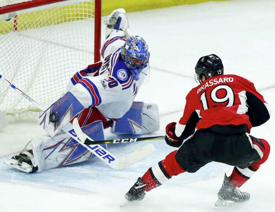 New York Rangers goaltender Henrik Lundqvist (30) makes a save as Ottawa Senators' Derick Brassard (19) looks on during the third period of an NHL hockey game in Ottawa on April 8, 2017. Photo: Fred Chartrand — The Canadian Press Via AP  / The Canadian Press