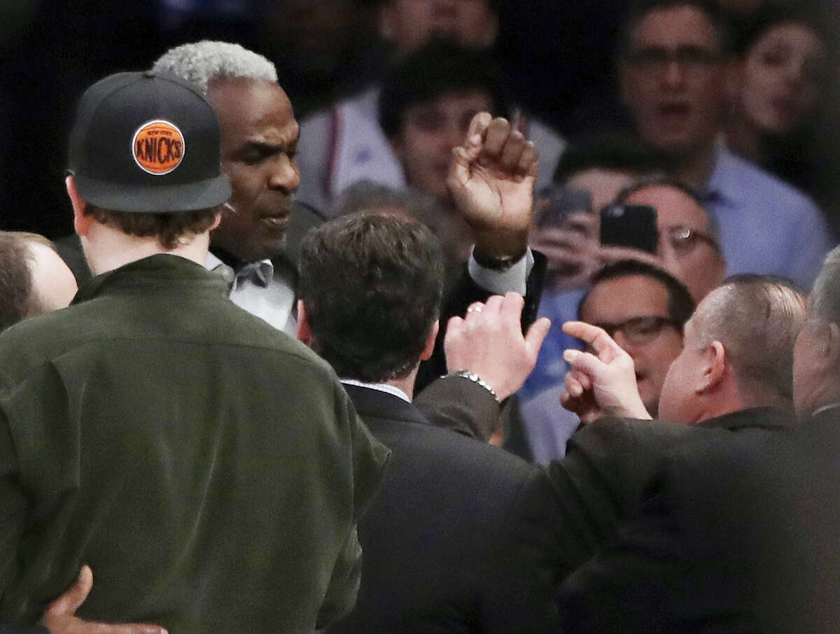 Former New York Knicks player Charles Oakley exchanges words with a security guard during the first half of an NBA basketball game between the New York Knicks and the LA Clippers on Feb. 8, 2017 in New York.