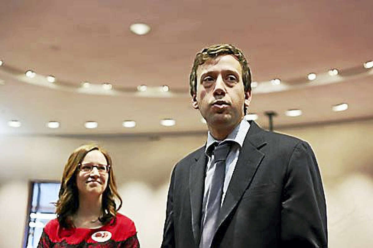 State Rep. Matt Lesser, D-Middletown, right, stands with Catherine Bailey, legal and public policy director for the CT Women's Education and Legal Fund.