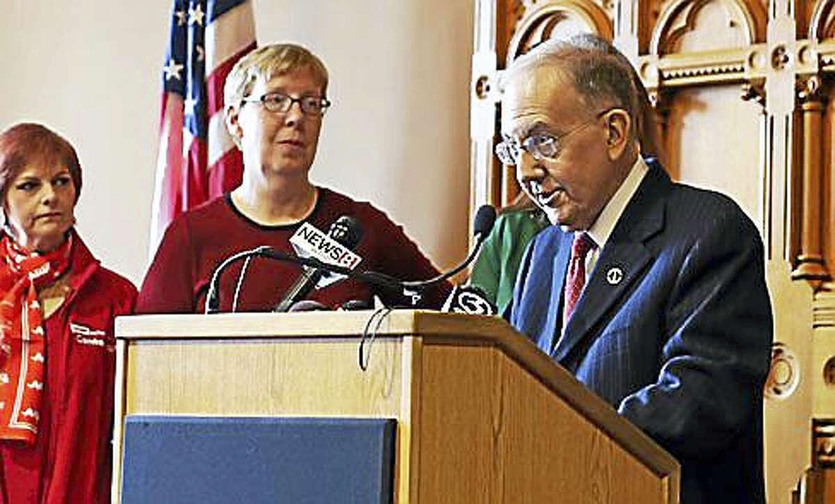 Senate President Martin Looney speaks Thursday at the podium in Hartford