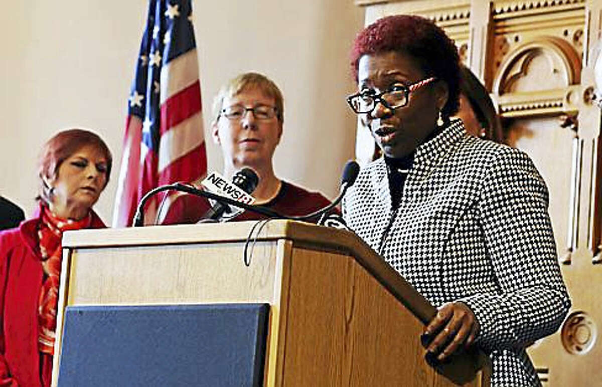Rep. Robyn Porter, D-New Haven, speaks Thursday in Hartford to advocate for a higher minimum wage in Connecticut