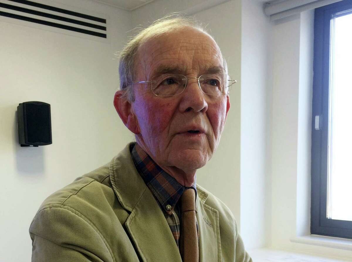 Consultant psychiatrist Dr. Don Williams speaks to the Associated Press in his office in London on Feb. 14, 2017. The degenerative damage potentially caused by repeated blows to the head in soccer has been highlighted by a rare study of brains of a small number of retired players who developed dementia. Williams played a key role in the research after starting to monitor former footballers who were diagnosed with dementia from 1980.