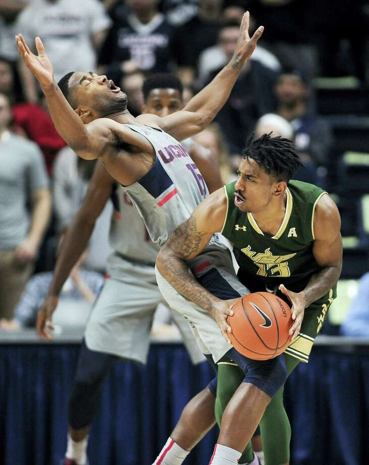 Not only has Rodney Purvis been putting on a show offensively of late, but he's has also had a significant impact on defense, drawing a charge from South Florida's Geno Thorpe here last week. Photo: Jessica Hill — The Associated Press  / AP2017