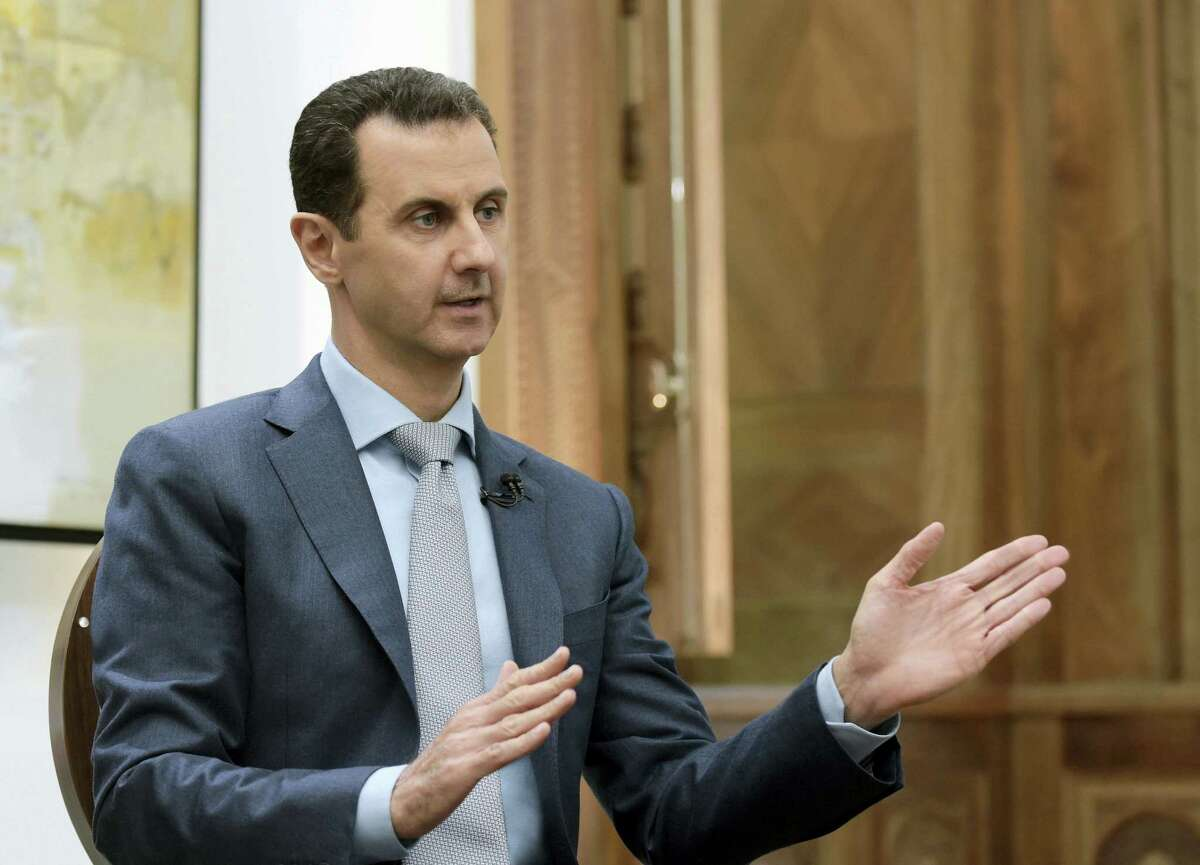 """In this Feb. 10, 2017 photo released by the Syrian official news agency SANA, Syrian President Bashar Assad speaks during an interview with Yahoo News in Damascus, Syria. Syria decried a U.S. missile strike early Friday, April 7, 2017 on a government-controlled air base where U.S. officials say the Syrian military launched a deadly chemical attack earlier this week. Syria called the operation """"an aggression"""" that killed at least six people."""