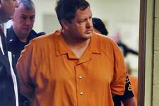 In this Sunday, Nov. 6, 2016, file photo, Todd Kohlhepp's enters the courtroom of Judge Jimmy Henson for a bond hearing at the Spartanburg Detention Facility in Spartanburg, S.C. A South Carolina woman who spent two months chained inside a metal container says her captor bragged that he was good at killing people and warned her she could be next if she fought back or ran. Brown and her boyfriend had been missing since Aug. 31, when they went to Kohlhepp's rural property, thinking they were going to clear underbrush.