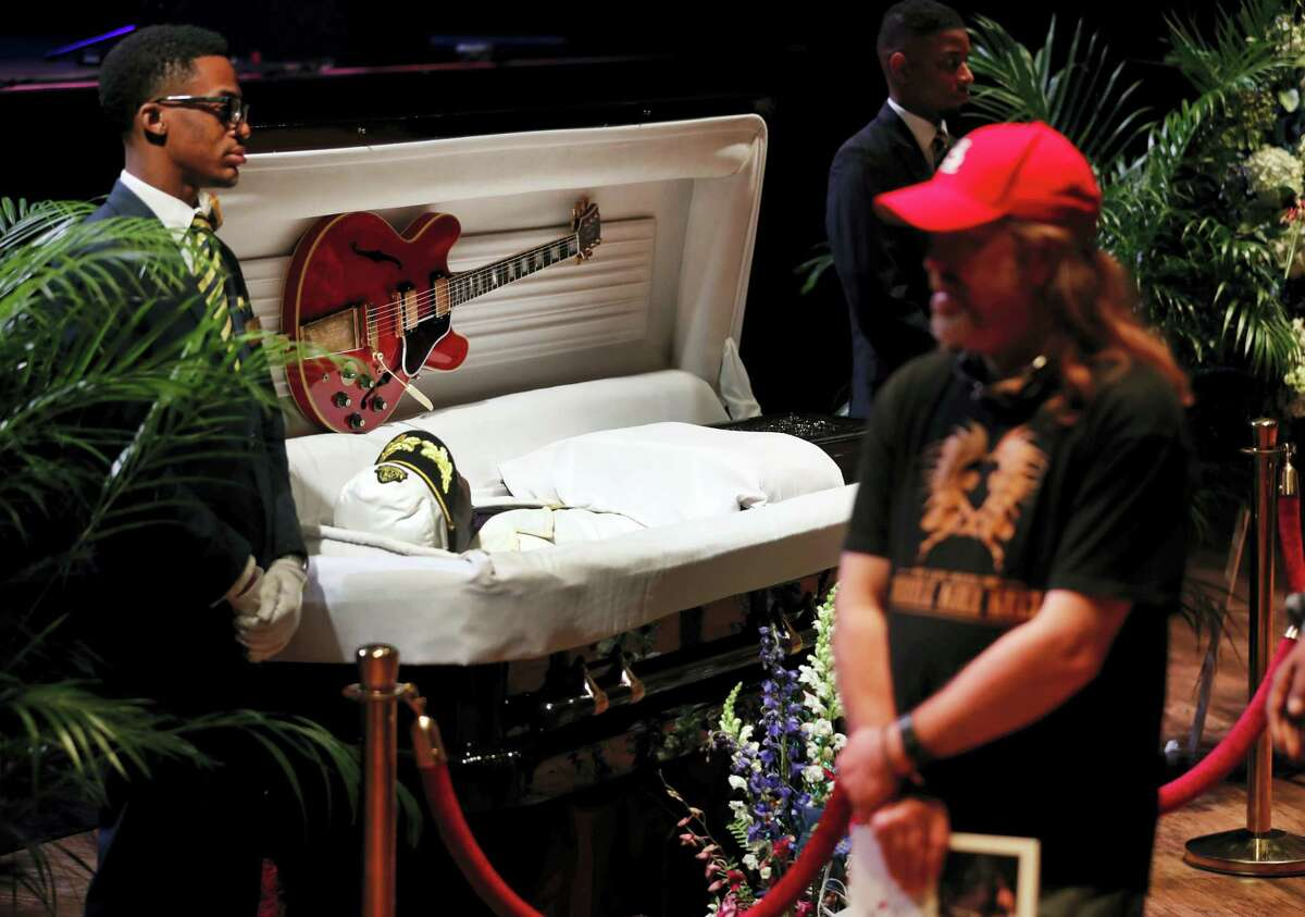 """Fans pay their respects to the rock 'n' roll legend Chuck Berry during a public viewing Sunday, April 9, 2017, in St. Louis. The man behind such classics as """"Johnny B. Goode,"""" ''Sweet Little Sixteen"""" and """"Roll Over Beethoven"""" died on March 18 at the age of 90. (AP Photo/Jeff Roberson)"""