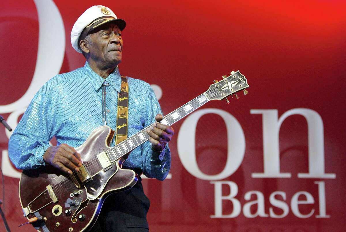 FILE - In this Nov. 13, 2007, file photo, legendary U.S. musician Chuck Berry performs on stage at the Avo Session in Basel, Switzerland. Fans can file past Berry's casket later Sunday, April 9, 2017, at a St. Louis club where he often performed. After the public viewing, a private service will be held for family and friends of the music legend, who died March 18, 2017, at age 90. (Peter Klaunzer/Keystone via AP, File)