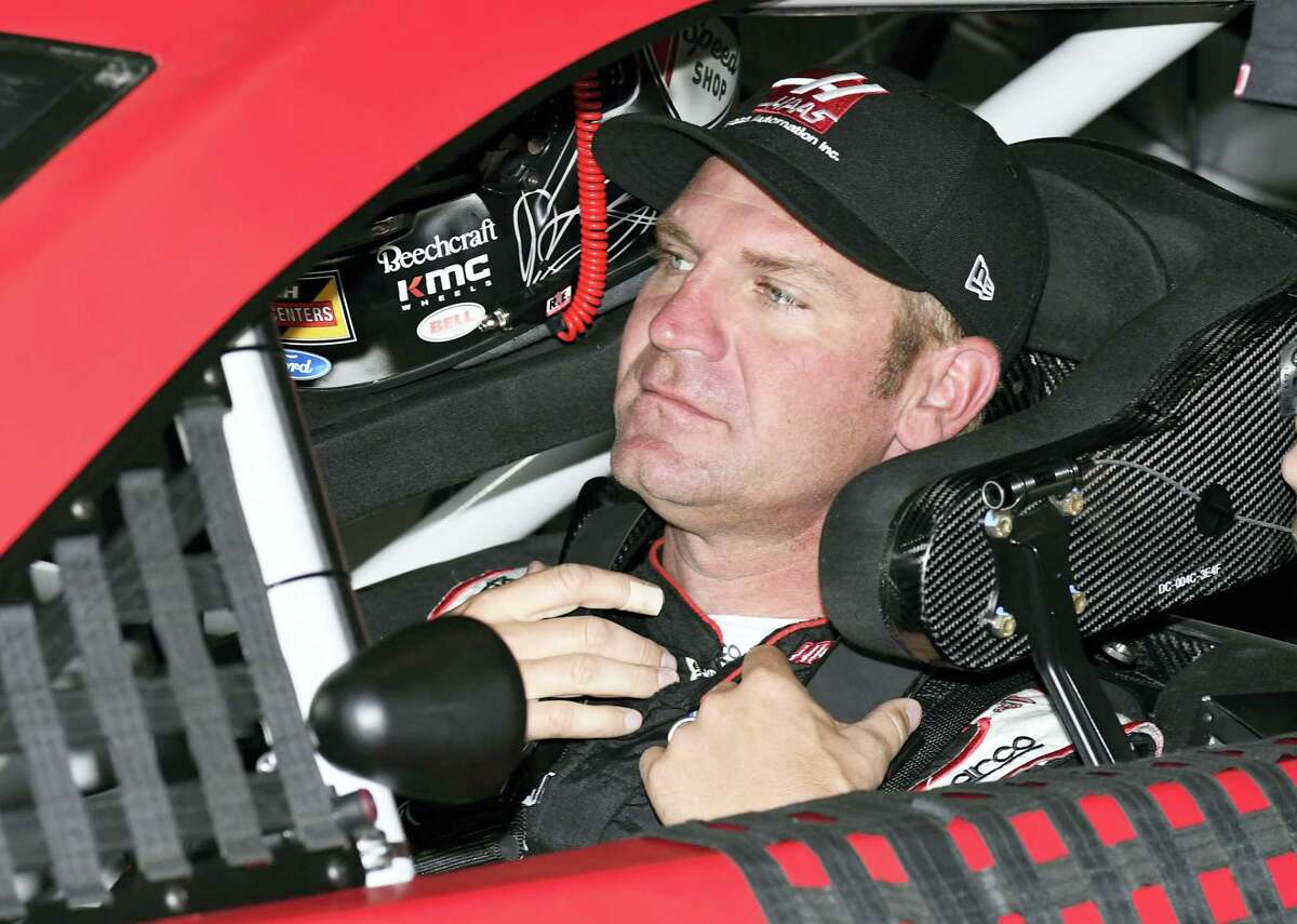 Clint Bowyer sits in his car during a practice session for Sunday's NASCAR Cup Series auto race a at Texas Motor Speedway in Fort Worth, Texas, Saturday, April 8, 2017. (AP Photo/Larry Papke)