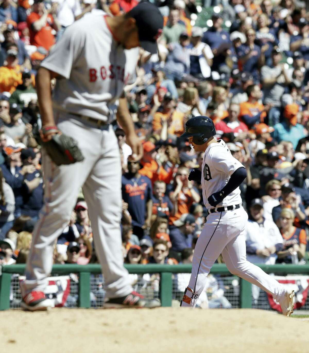 Red Sox starting pitcher Eduardo Rodriguez stands on the mound as the Tigers' Jose Iglesias rounds the bases during the third inning Saturday in Detroit.