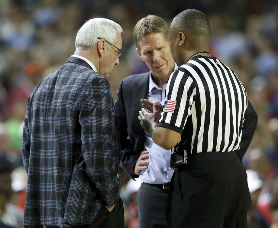 North Carolina head coach Roy Williams, left, and Gonzaga head coach Mark Few talk with an official during the national championship game on Monday. Photo: The Associated Press File Photo  / Copyright 2017 The Associated Press. All rights reserved.