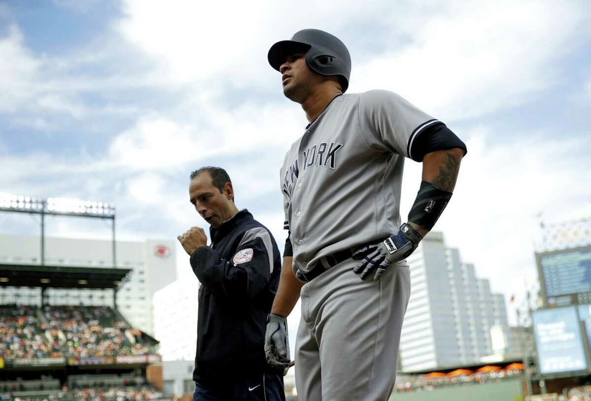 The Yankees' Gary Sanchez walks off the field after injuring himself on Saturday.