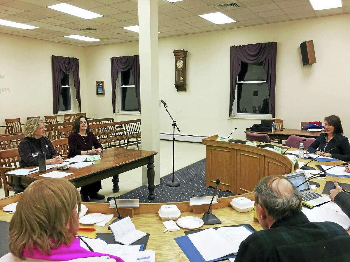 Kim Roy, seated on the left hand table on the left, was recently hired to become the new assistant principal in Winsted. Roy introduced herself to the Board of Education Tuesday.