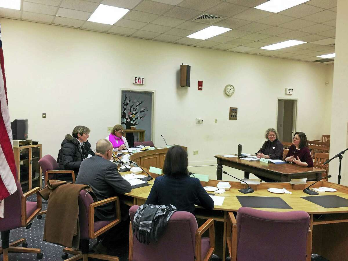 Kim Roy, seated on the right, introduced herself to the Winsted Board of Education Tuesday.