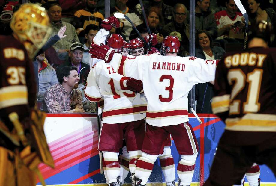 Denver left wing Jarid Lukosevicius (14) celebrates with teammates after scoring against Minnesota-Duluth during the second period Saturday. Photo: Nam Y. Huh — The Associated Press  / Copyright 2017 The Associated Press. All rights reserved.
