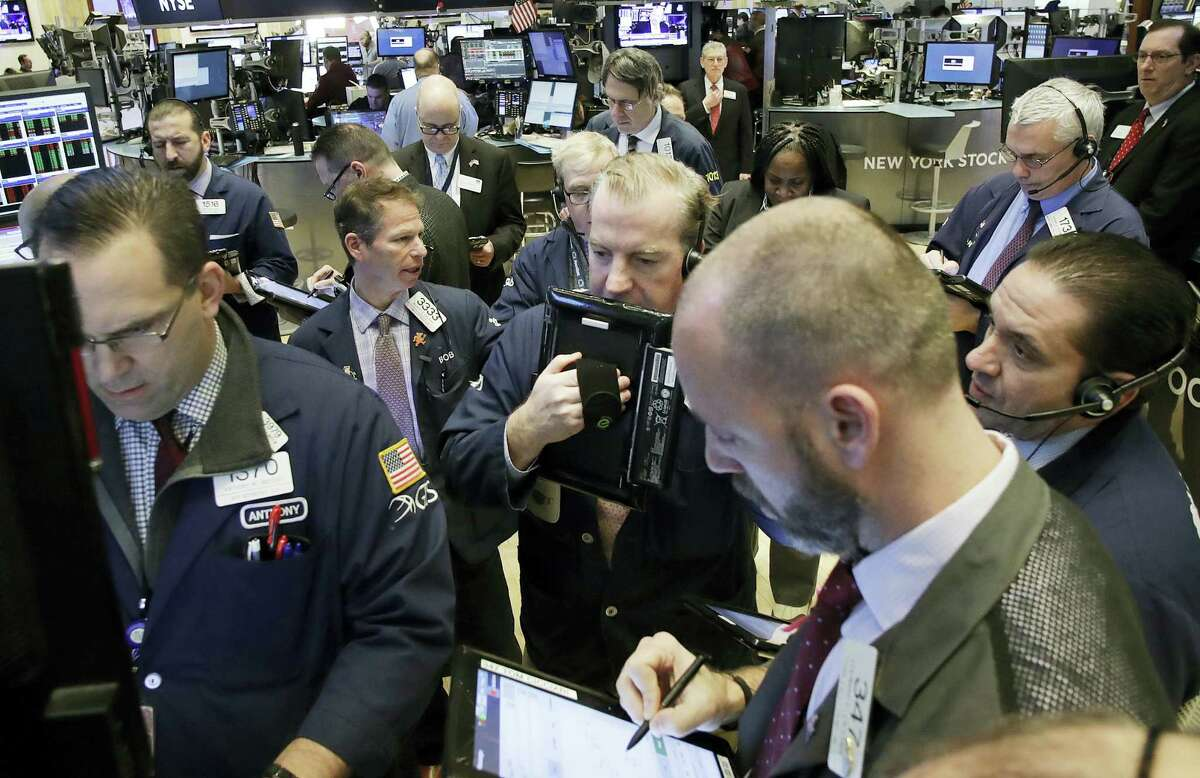 Stock traders follow market activity at the New York Stock Exchange.