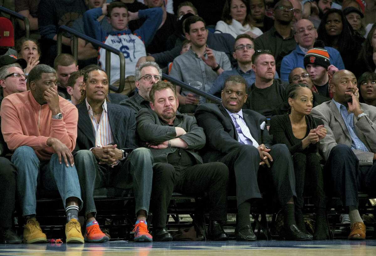 Madison Square Garden chairman James Dolan, center left, sits with former New York Knicks team members and others as he watched the Knicks take on the San Antonio Spurs during an NBA basketball game at Madison Square Garden in New York on Feb. 12, 2017.