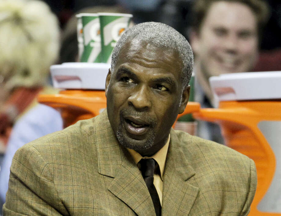 In this Jan. 20, 2011 photo, Charlotte Bobcats assistant coach Charles Oakley watches from the bench in the first half of an NBA basketball game against the Philadelphia 76ers in Charlotte, N.C. A person briefed on the discussions tells The Associated Press that Madison Square Garden has lifted its ban of Charles Oakley. The person who spoke to the AP on Tuesday, Feb. 14, 2017 on condition of anonymity because the discussions were to remain private, says the former Knicks star who was arrested at a game last week is welcome back at the arena. Madison Square Garden chairman James Dolan banned Oakley on Friday, two days after the former power forward had an altercation with security guards while attending a game. Photo: AP Photo/Chuck Burton, File  / 2011 AP