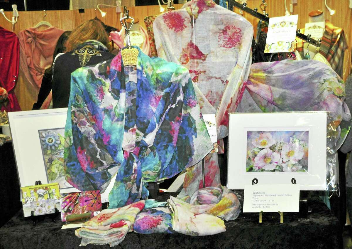 A display of Pam's Pashmina's display at the Connecticut Flower Show, with the inspiration, Carol Wallace's paintings, for the delicate designs of her scarves.