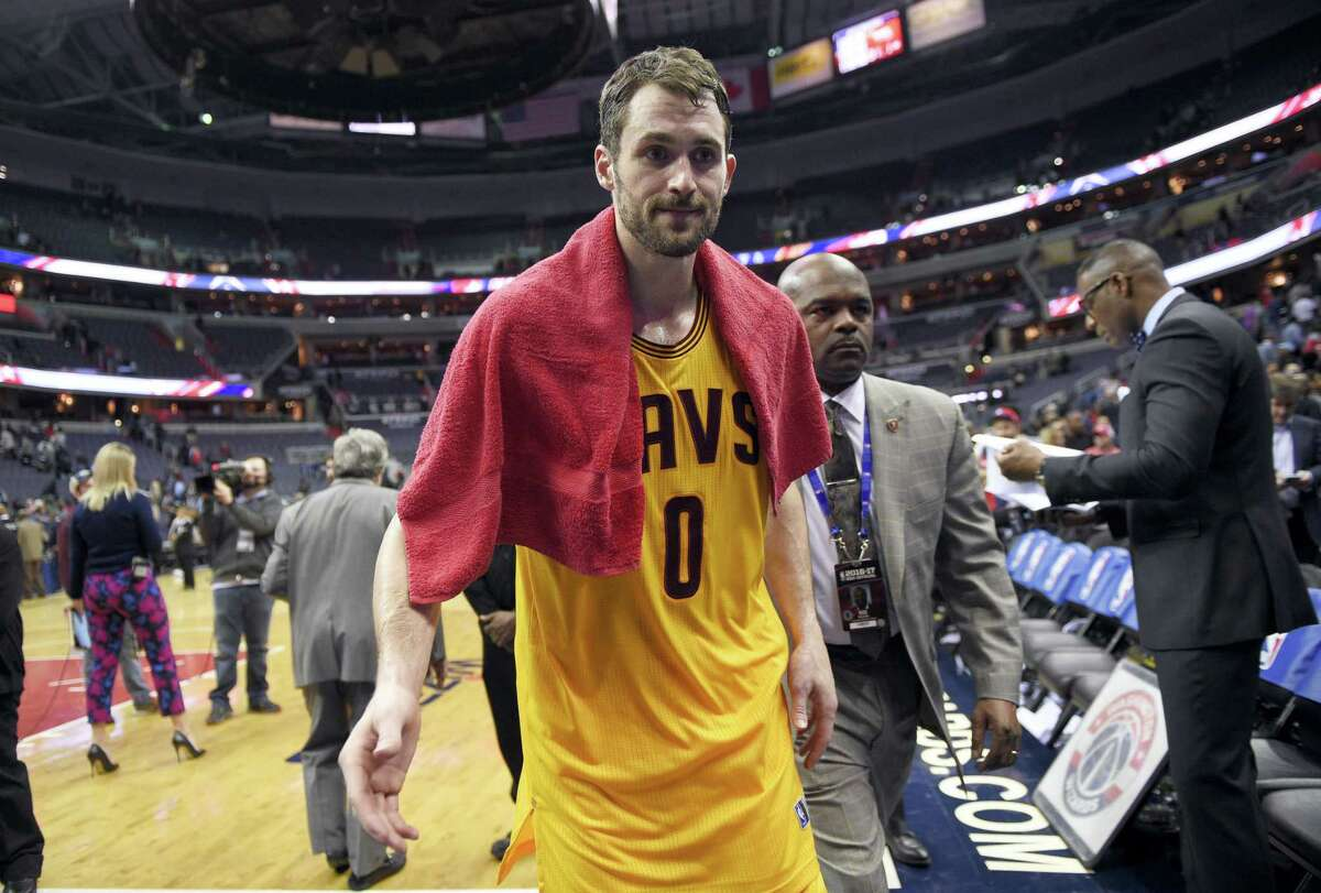 In this Feb. 6, 2017 photo, Cleveland Cavaliers forward Kevin Love (0) leaves the court after an NBA basketball game against the Washington Wizards, in Washington. Love will be out at least six weeks following left knee surgery. Love had the operation on his left knee on Tuesday, Feb. 14, 2017 in New York.