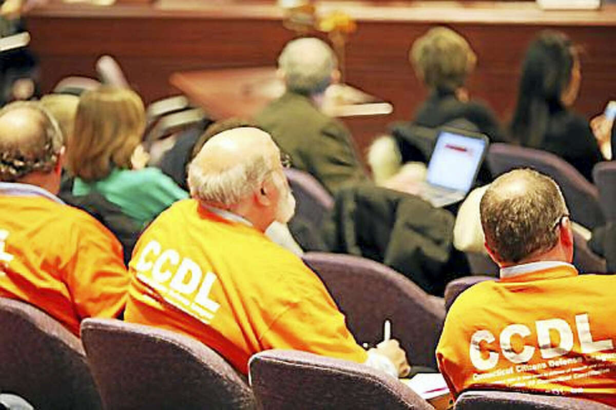 Connecticut Citizens Defense League members listen to testimony on the bill.