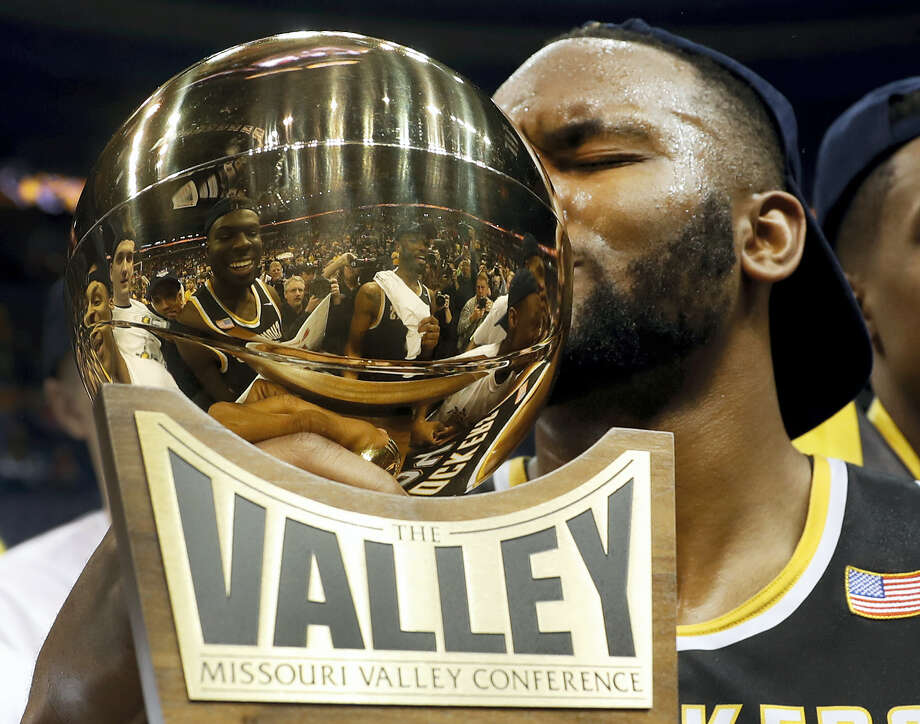 Wichita State's Shaquille Morris kisses the trophy after defeating Illinois State in the Missouri Valley Conference championship game. Photo: The Associated Press File Photo  / Copyright 2017 The Associated Press. All rights reserved.