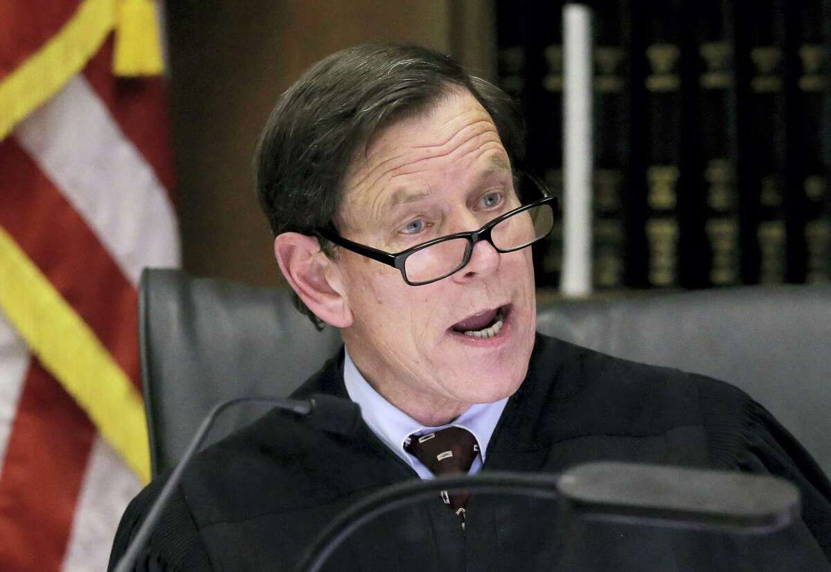 Judge Jeffrey Locke instructs members of the jury following closing arguments Thursday.