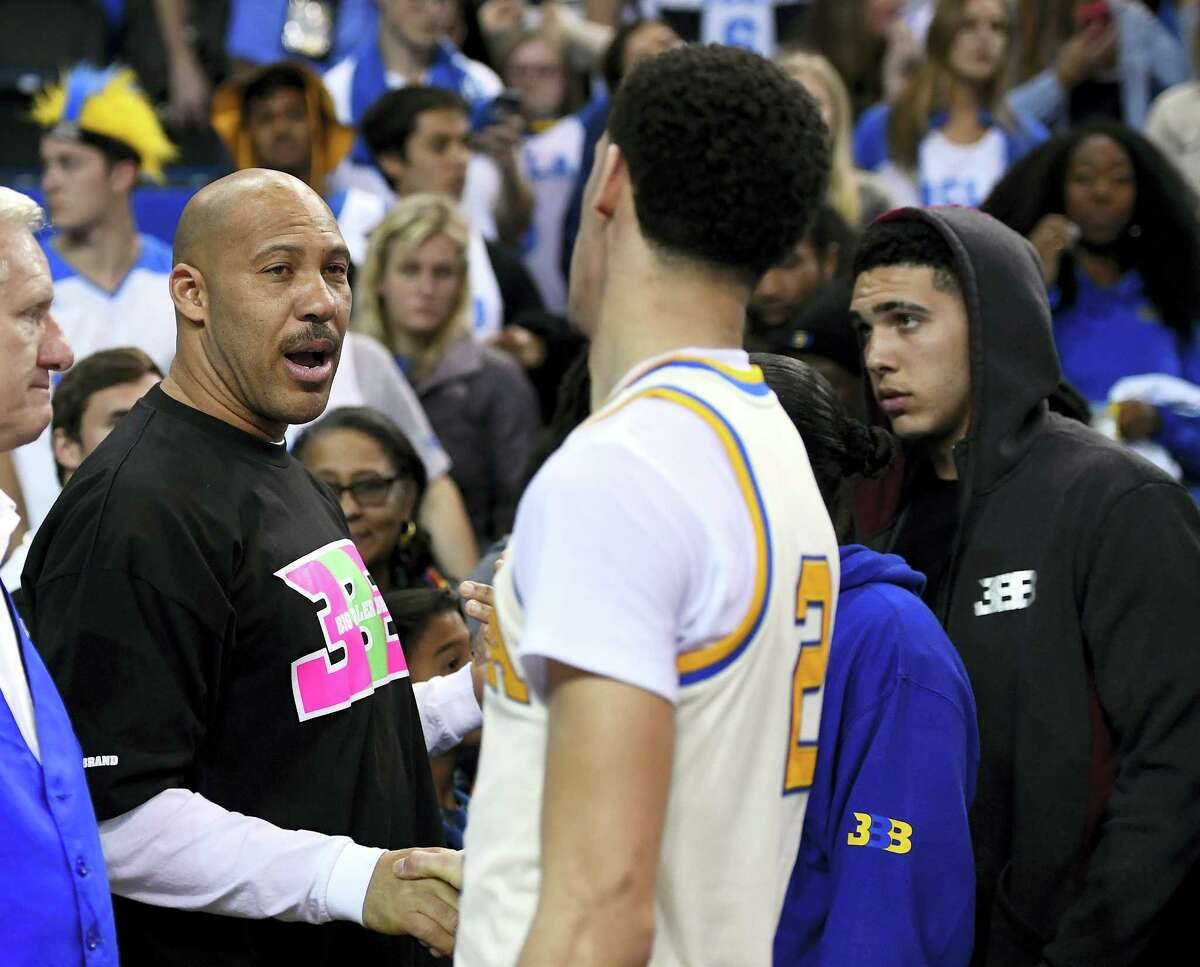 UCLA guard Lonzo Ball, right, shakes hands with his father LaVar following a game earlier this season.