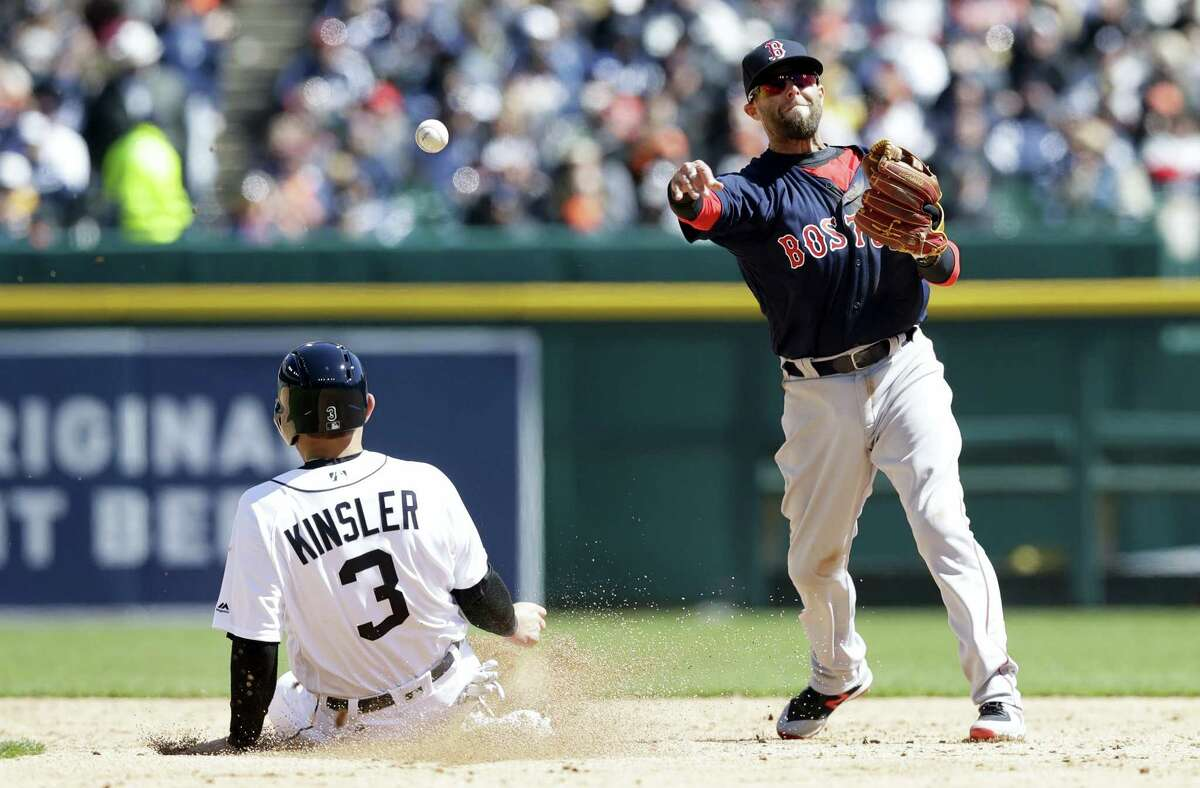 Red Sox second baseman Dustin Pedroia throws to first to complete a double play in the third inning as the Tigers' Ian Kinsler slides into second on Friday.