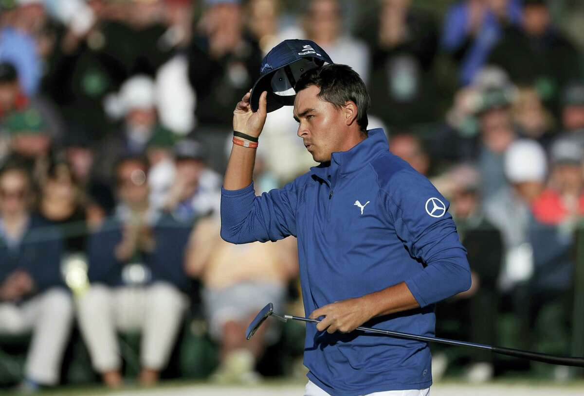Rickie Fowler tips his hat on the 18th green during the second round of the Masters on Friday.