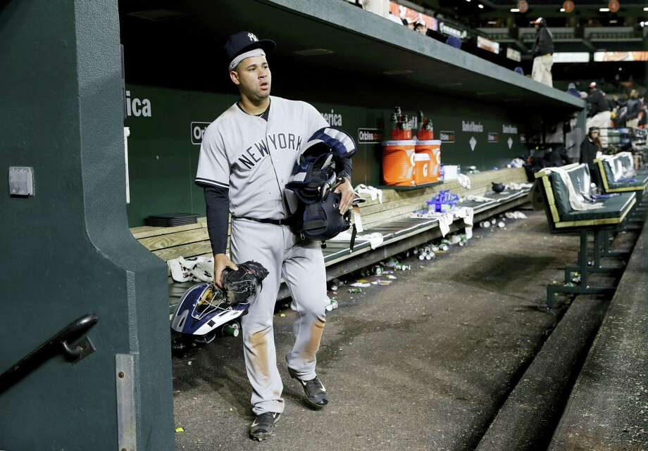 Yankees catcher Gary Sanchez walks out of an empty dugout after Friday's loss to the Orioles.. Photo: Patrick Semansky — The Associated Press  / Copyright 2017 The Associated Press. All rights reserved.
