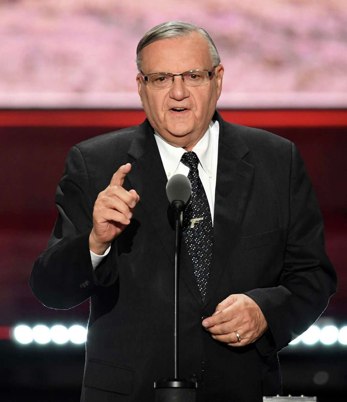 (FILES) This file photo taken on July 21, 2016 shows Sheriff Joe Arpaio speaking on the last day of the Republican National Convention in Cleveland, Ohio. In a statement released by the White House on August 25, 2017, US President Donald Trump granted a Presidential pardon to Arpaio, former Sheriff of Maricopa County, Arizona. Arpaio, 85, was convicted of criminal contempt of court charges for violating an order that he refrain from detaining illegal immigrants, which the courts said was the job of federal authorities. / AFP PHOTO / Robyn BECKROBYN BECK/AFP/Getty Images