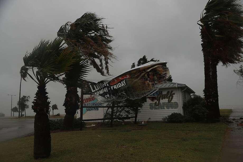 CORPUS CHRISTI, TX - AUGUST 25:  A sign blows in the wind after being partially torn from its frame by winds from Hurricane Harvey on August 25, 2017 in Corpus Christi, Texas.  Hurricane Harvey has intensified into a major hurricane and is aiming for the Texas coast with the potential for up to 3 feet of rain and 125 mph winds.  (Photo by Joe Raedle/Getty Images) Photo: Joe Raedle, Getty Images
