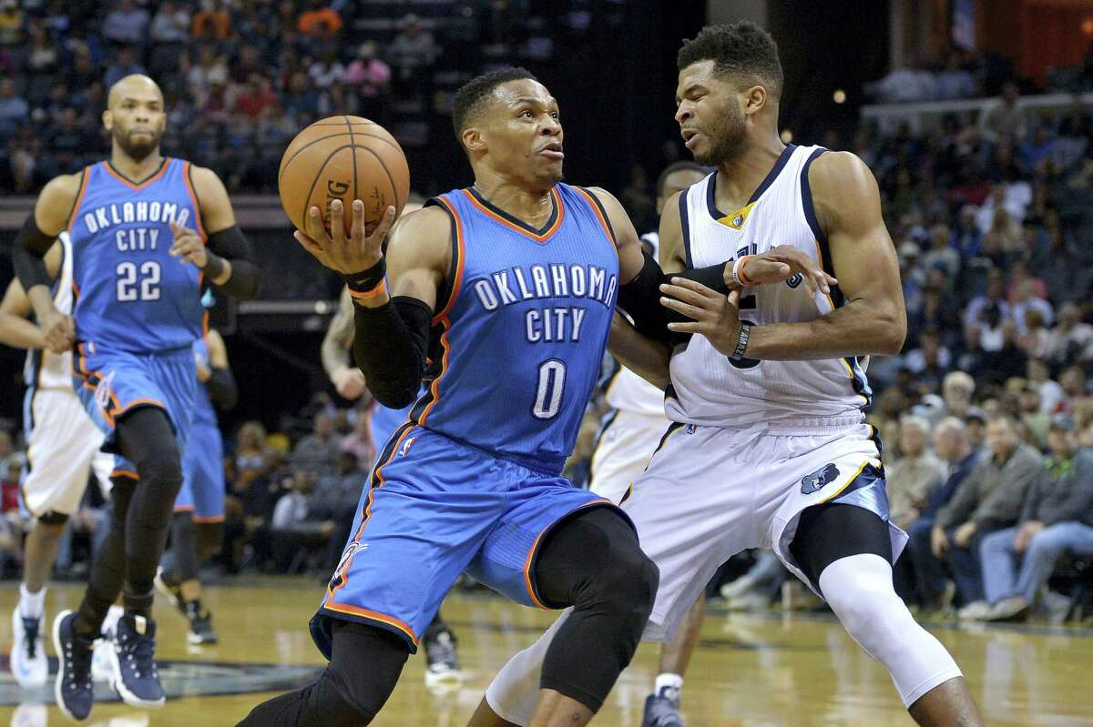 Oklahoma City Thunder guard Russell Westbrook (0) drives against Memphis Grizzlies guard Andrew Harrison, right, during the first half of an NBA basketball game on April 5, 2017 in Memphis, Tenn.