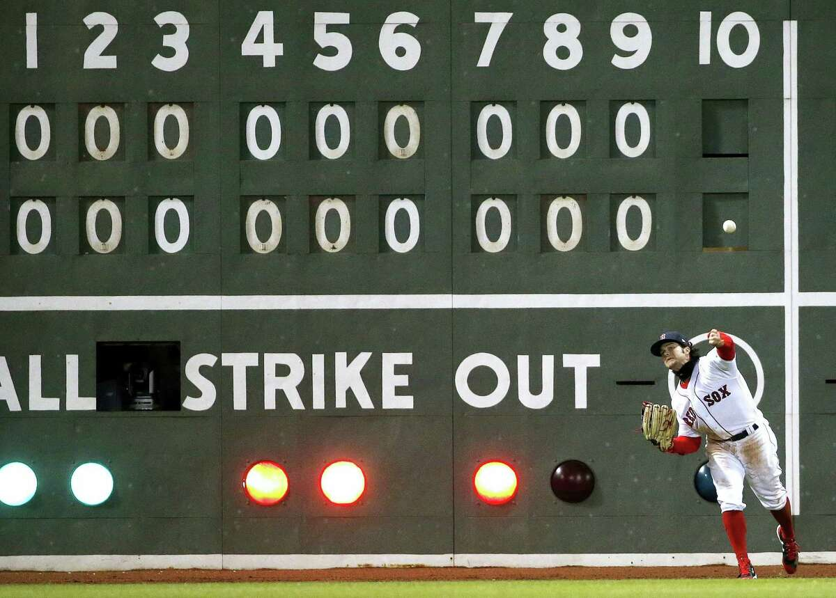 Andrew Benintendi throws the ball during Wednesday's game against the Pirates.