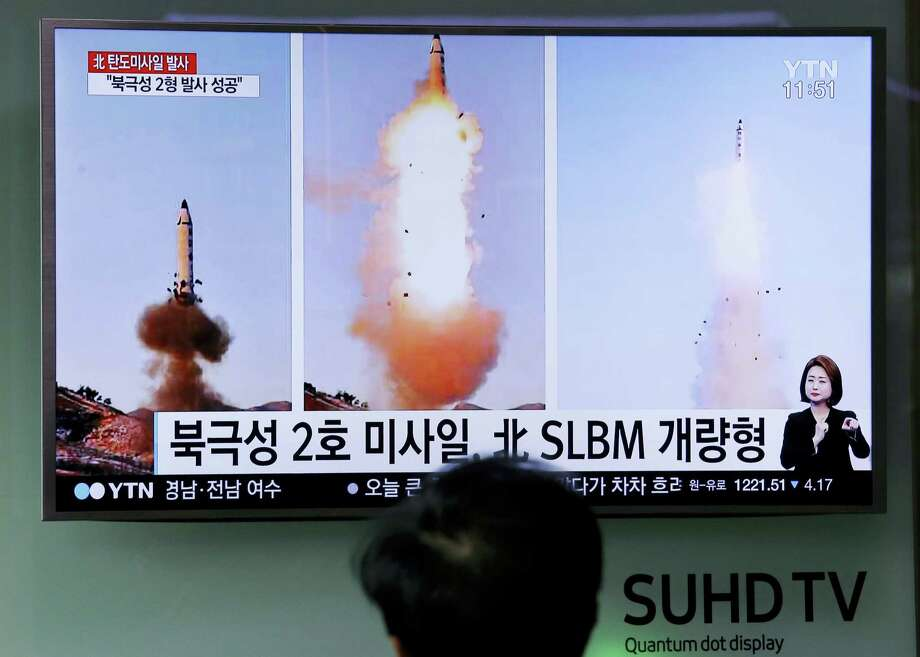 """A man watches a TV news program showing photos published in North Korea's Rodong Sinmun newspaper of North Korea's """"Pukguksong-2"""" missile launch at Seoul Railway station in Seoul, South Korea on Feb. 13, 2017. In an implicit challenge to President Donald Trump, North Korea fired a ballistic missile early Sunday in its first such test of the year. The letters read """"Pukguksong-2 missile and advanced Submarine-Launched Ballistic Missiles."""" Photo: AP Photo/Ahn Young-joon  / Copyright 2017 The Associated Press. All rights reserved."""