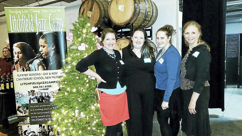 "Photo by N.F. AmberyRachel Steier-White, Ellie Lambert, Tegan Ryan and Lisa Cruse of the Litchfield Performing Arts supervised the festivities at the first annual ""Spirits of Love"" Valentine's Day event at Litchfield Distillery at 569 Bantam Road in Litchfield on Saturday, Feb. 11. Through door tickets sold and a ""Giving Tree"", left, where guests donated checks for specific solicited materials written up a paper ornament and hung upon a holiday tree, the event raised an estimated $5,000 to benefit the Litchfield Jazz Camp, a summer program that instructs young people in jazz. Photo: Digital First Media"