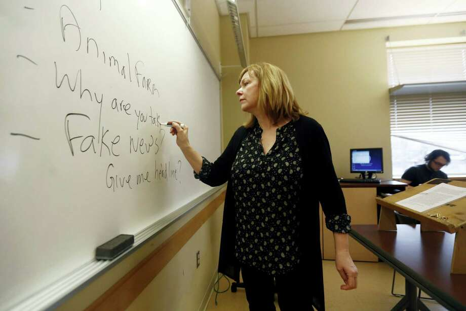 In this Jan. 20, 2017 photo, Pat Winters Lauro, a journalism professor at Kean University in Union, N.J., leads a class discussion talking about fake news. Teachers from elementary school through college have been ramping up media literacy training to recognize bogus reports and understand their potential to weaken civic culture. Photo: AP Photo/Julio Cortez  / Copyright 2017 The Associated Press. All rights reserved.