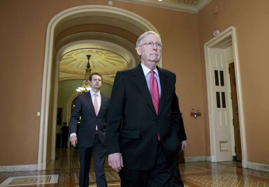 Senate Majority Leader Mitch McConnell of Ky. walks to his office on Capitol Hill in Washington on April 6, 2017, as he is expected to change Senate rules to guarantee confirmation of Supreme Court nominee Neil Gorsuch. Republicans are poised to lower the threshold for a vote on Supreme Court nominees from 60 votes to a simple majority, eliminating the ability of Democrats to keep Gorsuch off the high court. Photo: AP Photo — J. Scott Applewhite  / Copyright: AP