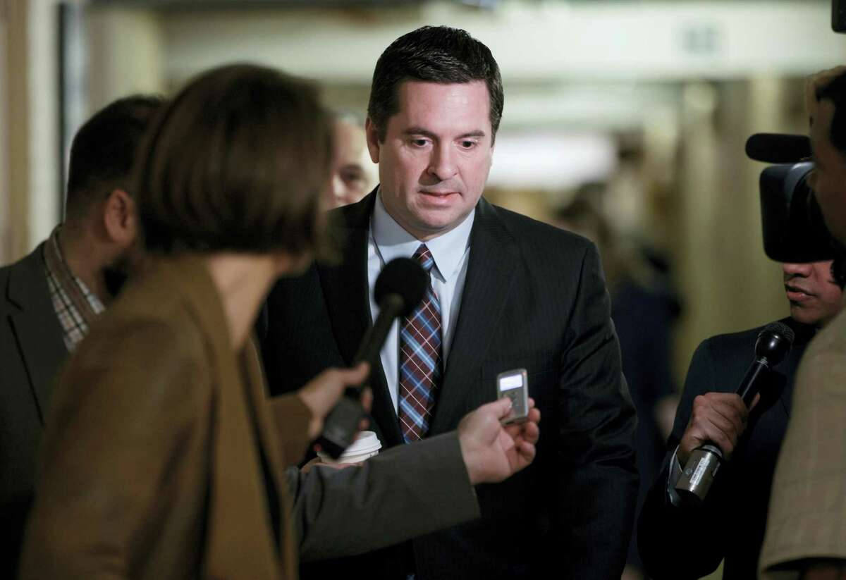In this March 28, 2017, file photo, House Intelligence Committee Chairman Rep. Devin Nunes, R-Calif. is pursued by reporters on Capitol Hill in Washington. Nunes says he's temporarily stepping aside from Russia probe amid ethics accusations.
