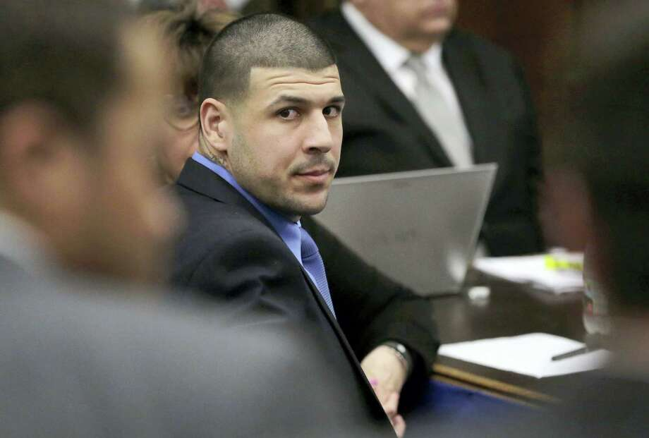 Former New England Patriots tight end Aaron Hernandez is seated during closing arguments in his trial at Suffolk Superior Court, Thursday, April 6, 2017, in Boston. Hernandez is on trial for the July 2012 killings of Daniel de Abreu and Safiro Furtado who he encountered in a Boston nightclub. The former NFL player is already serving a life sentence in the 2013 killing of semi-professional football player Odin Lloyd. Photo: AP Photo/Steven Senne, Pool   / Copyright 2017 The Associated Press. All rights reserved.
