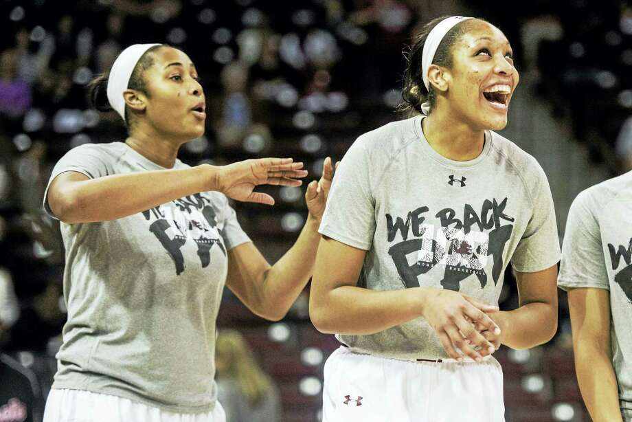South Carolina center Alaina Coates, left, and A'ja Wilson will look to end UConn's 99-game winning streak on Monday night. Photo: The Associated Press File Photo  / The Associated Press