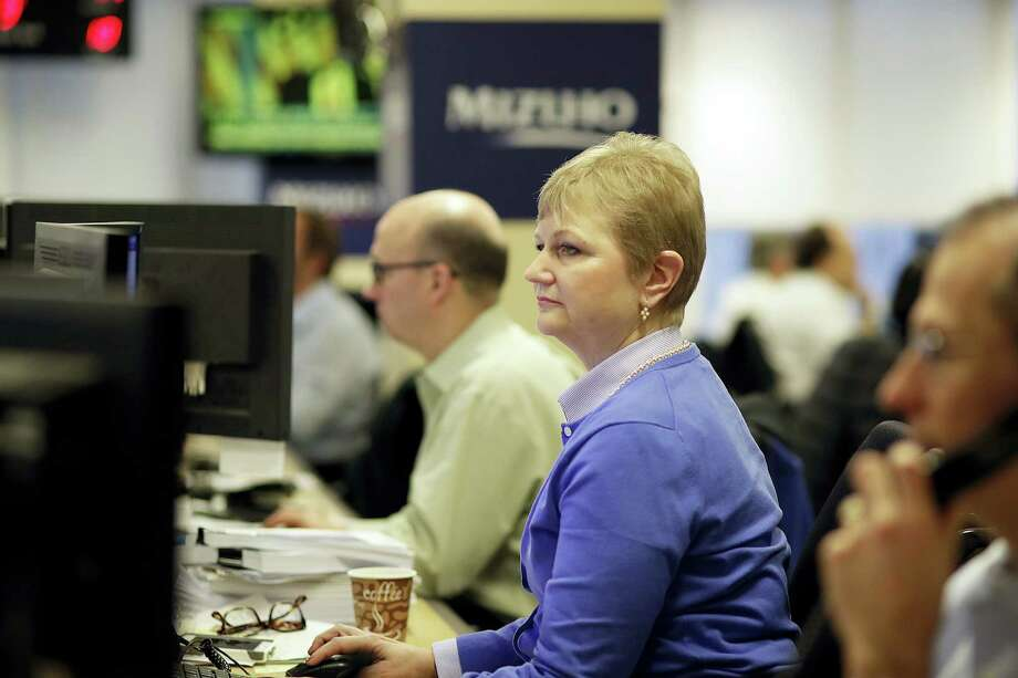 Traders work on the Mizuho Americas trading floor in New York. Photo: Mark Lennihan — The Associated Press  / Copyright 2017 The Associated Press. All rights reserved.