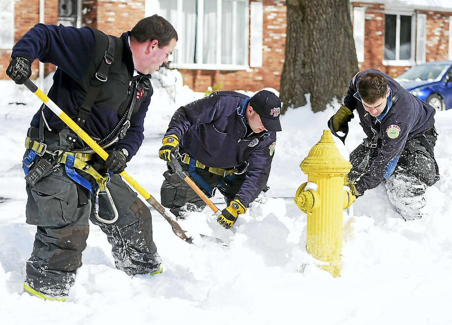 Peter Hvizdak — New Haven Register Hamden Fire Captain Adam Barletta with Hamden firefighters Cal Brennan and John Coughlin, left to right, dig out a fire hydrant on Mill Rock Road in Friday, February 10, 2017. Photo: ©2017 Peter Hvizdak / ©2017 Peter Hvizdak