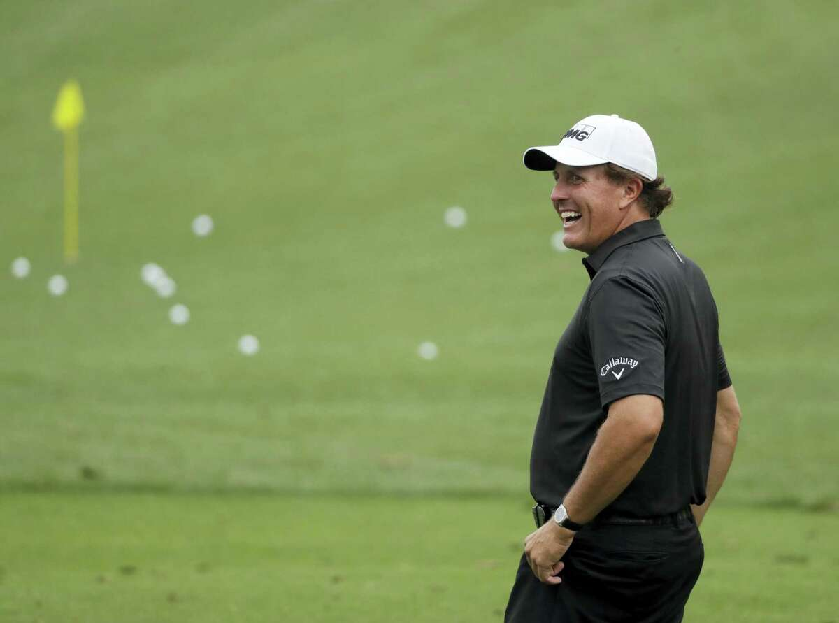Phil Mickelson laughs on the range during a practice round for the Masters golf tournament on April 5, 2017 in Augusta, Ga.