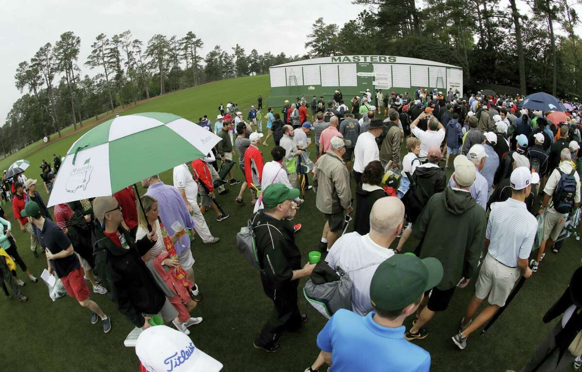 Fans leave Augusta National for a weather warning during a practice round for the Masters golf tournament on April 5, 2017 in Augusta, Ga.