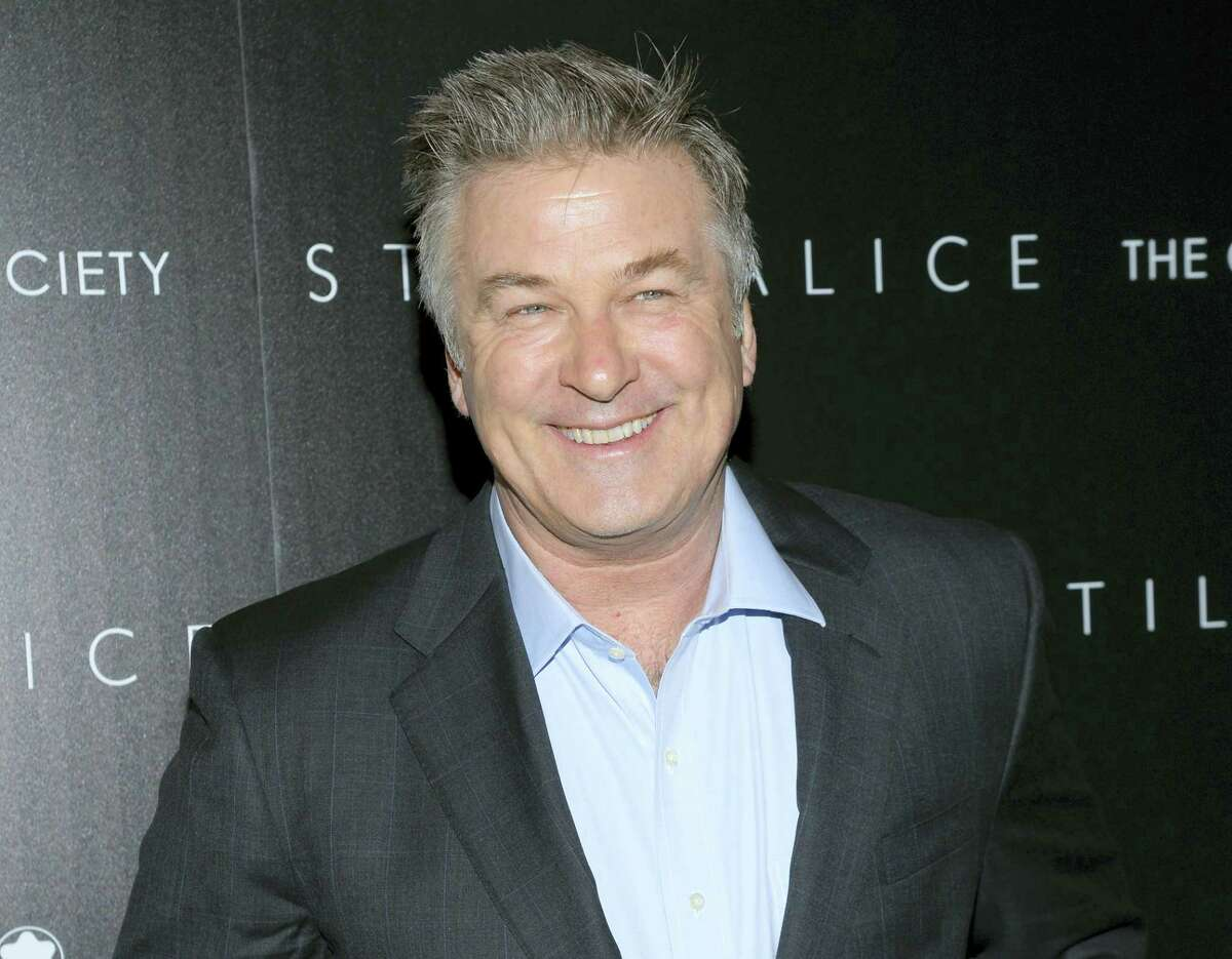 """In this Jan. 13, 2015 photo, actor Alec Baldwin attends a special screening of his film """"Still Alice"""" in New York. Baldwin, who has scored in guest shots on """"Saturday Night Live"""" with his mocking impersonation of Donald Trump since the campaign's final weeks, presided Saturday night, Feb. 11, 2017 as guest host of the NBC comedy show, serving up yet another Trump masquerade. In his spoof, President Trump made good on a tweeted vow to """"see you in court"""" directed at the three Ninth Circuit federal judges who last week refused to lift a stay preventing his immigration ban from being enforced."""