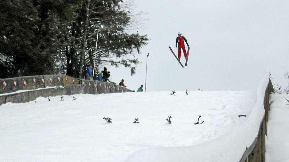 A ski jumper flies through the air on Satre Hill in Salisbury. Photo: Photo By John Torsiello