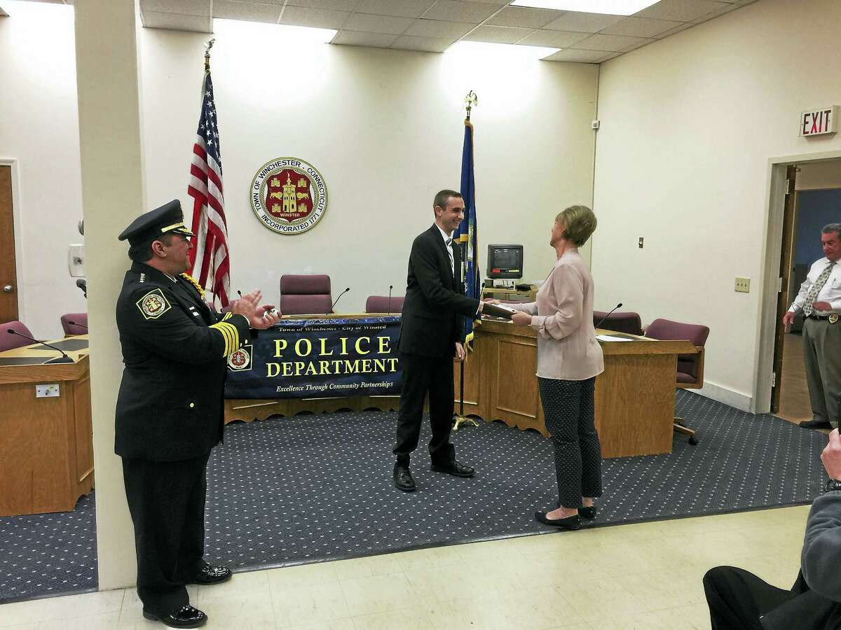 Brandon Simmons, 21, of Woodbury, was sworn-in as the newest member of the Winsted Police Department Wednesday.