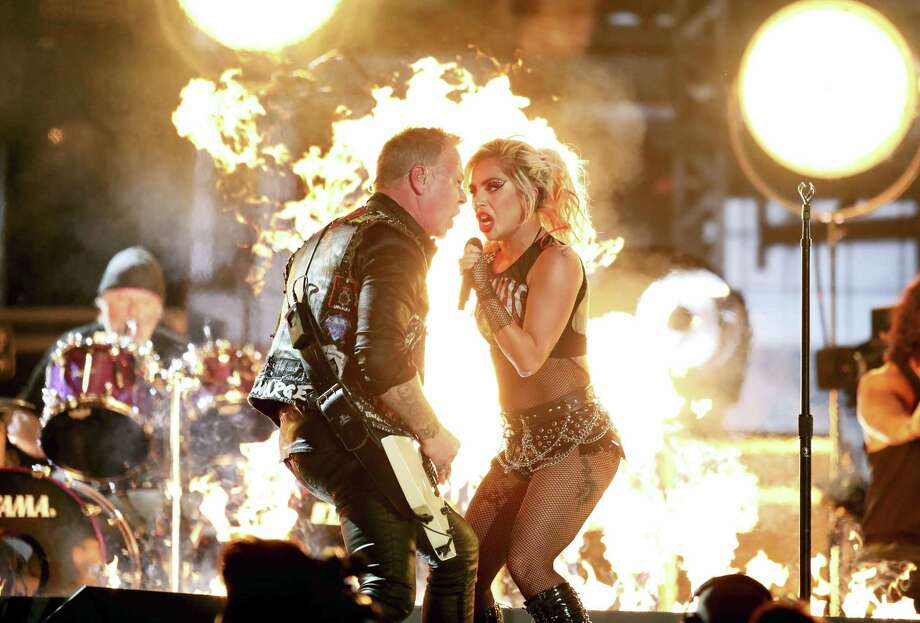 """Lady Gaga, right, and James Hetfield of """"Metallica"""" perform """"Moth Into Flame"""" at the 59th annual Grammy Awards on Sunday, Feb. 12, 2017, in Los Angeles. (Photo by Matt Sayles/Invision/AP) Photo: Matt Sayles/Invision/AP / 2017 Invision"""